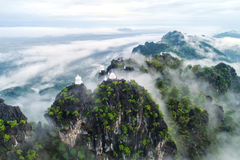Fog on the Mountain.Wat Mongkut Memorial Rachanusorn a public te. Mple on the hill. The wonderful thing is beautiful. It is located in Lampang, Thailand Stock Image