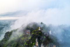 Fog on the Mountain.Wat Mongkut Memorial Rachanusorn a public te. Mple on the hill. The wonderful thing is beautiful. It is located in Lampang, Thailand Stock Photos