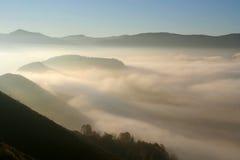 Fog in mountains Stock Photos