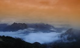 Fog in the mountains at dawn. Royalty Free Stock Images