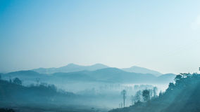 Fog between the mountains. A high density of fog surrounding the mountains  to flow Royalty Free Stock Photos
