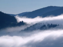 Fog between the mountains Stock Photos