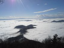 Fog and mountains. Thick fog that hugs mointains Stock Photos