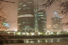 Fog at night city. Highrise buildings, river and fog at night city Royalty Free Stock Image