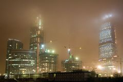 Fog at night city. Highrise buildings and fog at night city Stock Photo