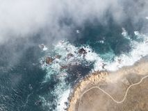 Fog and Northern California Coastline Aerial View. Fog drifts across the beautiful northern California coastline in Sonoma. Thick fog, generated by a layer of stock photo