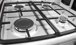 Fog?o de g?s moderno novo com os quatro queimadores para a cozinha, superf?cie de a?o inoxid?vel foto de stock
