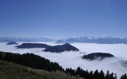 The fog-ocean over the swiss alps seen from Rigi-Kulm near Kaltb. Runn in Central Switzerland Royalty Free Stock Photos