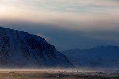 Fog in ocean. White snowy mountain, blue glacier Svalbard, Norway. Ice in ocean. Iceberg twilight in North pole. Pink clouds with royalty free stock photos