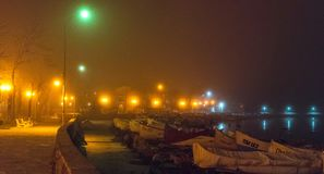 Fog on the old embankment of the night Pomorie in Bulgaria Stock Images