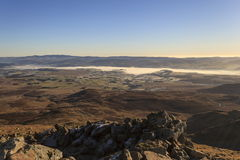 Fog over Bala lake. Fog sits over Bala lake on a cold winters morning viewed from Arenig fawr Royalty Free Stock Image