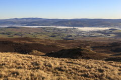 Fog over Bala lake. Fog sits over Bala lake on a cold winters morning viewed from Arenig fawr Stock Photos