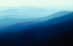 Fog over blue hills Stock Images