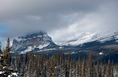 Fog over Castle Mountain in the Rocky Mountains, Alberta, Canada. Snow capped mountains in the Rocky Mountains, Alberta, Canada royalty free stock photo