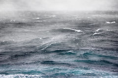 Fog over cold current in Kara sea. Arctic ocean has lost ice. Stormy weather six points on the scale of Bofort Royalty Free Stock Photography