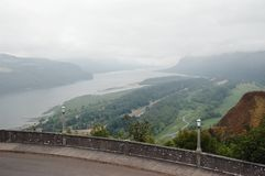 Fog over Columbia River Gorge. Grey foggy morning at Columbia River Gorge from Vista House viewpoint royalty free stock images