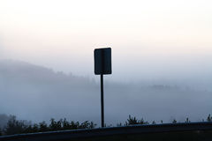 Fog over a country road Royalty Free Stock Photo