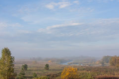 Fog over the forest early in the morning. Russia Royalty Free Stock Photo