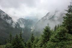 Fog over highway to mountains. Transfagarasan road. Romania Stock Photos