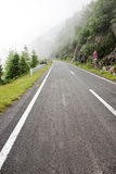 Fog over highway to mountains. Transfagarasan road. Romania Stock Photo