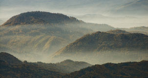 Fog over the hills. Beautiful autumn day in the foggy mountains stock photography