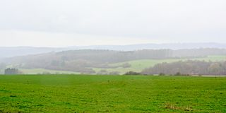 Mist over Ardennes hills landscape,. Fog over the hills of the Ardennes  in Liege, Belgium Royalty Free Stock Image