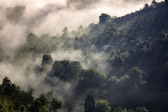 Fog over the hills of medieval Brasov. Royalty Free Stock Image