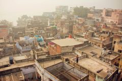 Fog over historical indian city with brick buildings with grunge walls. VARANASI, INDIA - JAN 3: Fog over historical indian city with brick buildings with grunge Royalty Free Stock Images