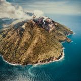 Fog over Indonesian volcano. Aerial drone shot. stock photo