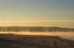 Fog over lake  Stock Photos