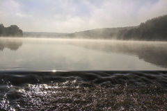 Fog over lake. And dam with sunrise Stock Images