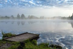Fog over the lake in the early morning Royalty Free Stock Images