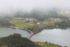 Fog over the lake. Lagoa das Sete Cidades-double lake on the island of Sao Miguel, Azores. Consists of two small lakes connected by a small strait. It is the Stock Images
