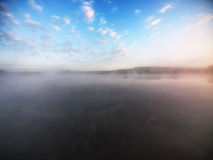 Fog over lake Stock Photos
