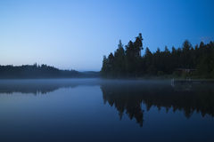 Fog over a lake Stock Photos