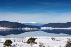 Fog over lake in winter Royalty Free Stock Image