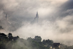 Fog over medieval city of Brasov. Historic medieval city of Brasov, Transylvania, Romania on a foggy morning. Autumn (fall), September 26th, 2016. The steeple Royalty Free Stock Images