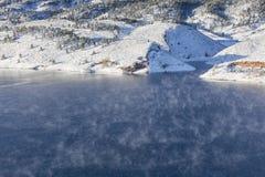 Fog over mountain lake Royalty Free Stock Photos