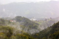 Fog over mountain landscape Stock Photo