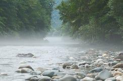 Fog over the mountain river. Morning fog over the mountain river Stock Photo