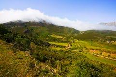 Fog over  mountains Stock Photos