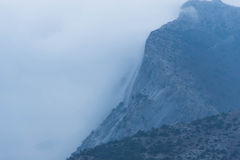 Fog over the mountains. A thick fog over the slopes of the mountains. Gloomy bad weather stock photos