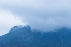 Fog over the mountains. A thick fog over the slopes of the mountains. Gloomy bad weather royalty free stock image