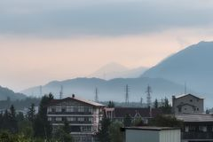 Foggy morning over the mountains and the village of Hakuba in Naga. Fog over the mountains and the village of Hakuba in Nagano in Japan Stock Photo