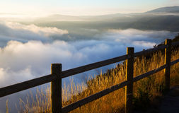 Fog over  mountains. Fog over wooded mountains in summer morning Royalty Free Stock Photos