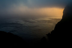 The fog over the Norway`s waters. Beautiful color of the sunset and the milky fog over the Norway`s waters Stock Image