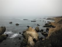 Fog over the Ocean and Rocky Seashore. At Montana de Oro State Park, Los Osos, California Stock Images