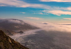 Fog over Pacific Coast Highway, Big Sur, California. Fog over coastline along Pacific Coast Highway in Big Sur, California at sunset Stock Image