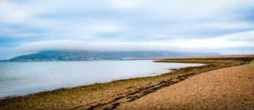 Fog Over Portland UK. A thick layer of fog hangs over the Isle Portland in the South of England Royalty Free Stock Images