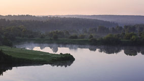 Fog over the Ptitsegradsky pond in the early hours. Royalty Free Stock Photo